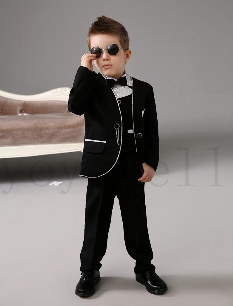 Why rent your child's tuxedo when you can purchase it for less? New Boys BLACK 5-Piece Tuxedo Set includes black polyester two button notch lapel coat with.