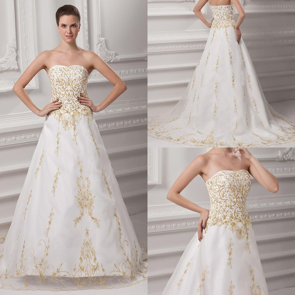 Vintage white and gold princess wedding gowns embroidery for Gold beaded wedding dress