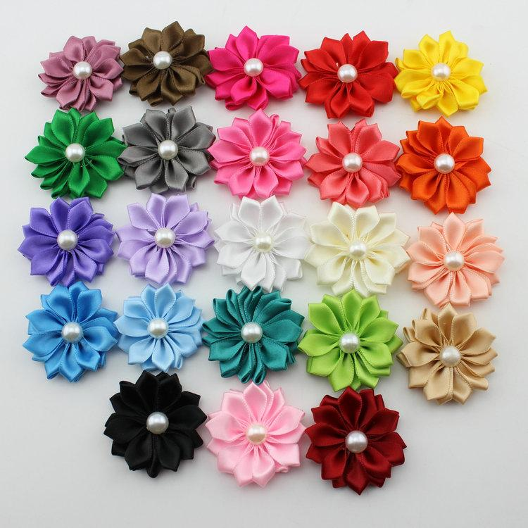 When given the task of making flower hair clips for our church's Mother Daughter Banquet/Luau, I had a hard time finding single flowers and the thought of making them by hand was overwhelming.