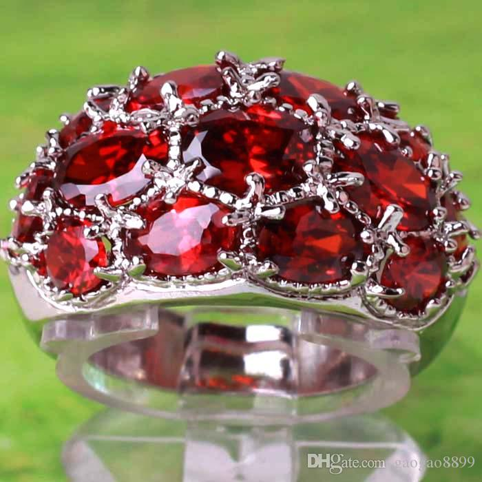 http://www.dhresource.com/0x0s/f2-albu-g1-M01-CA-95-rBVaGVR0K6WAbJqYAAD3r2T-RvQ683.jpg/beautiful-crystals-ruby-red-topaz-gemstones.jpg