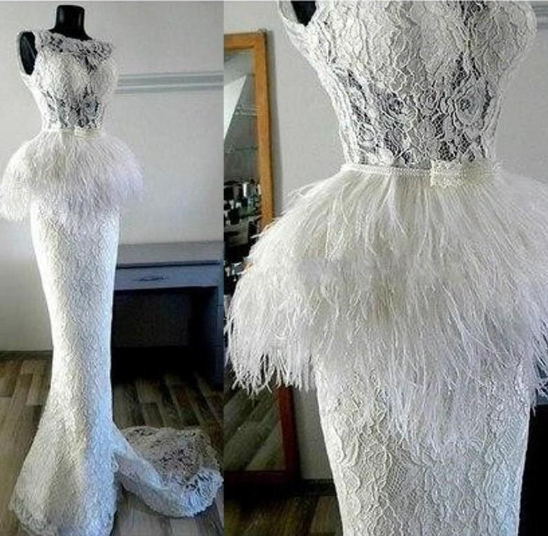 White lace mermaid wedding dresses with feather peplum for White feather wedding dress
