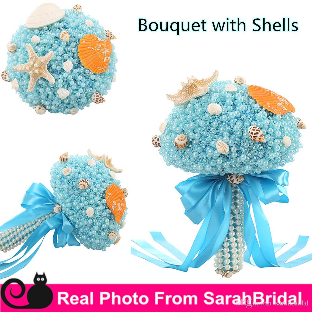2016 summer beach bridal wedding prom bouquets with shells pearls 2016 summer beach bridal wedding prom bouquets with shells pearls for brides bridesmaid holding flowers sale cheap luxury ribbon bow cheap flowers petals dhlflorist Gallery