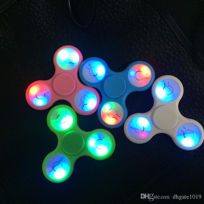 Led fidget spinner light up hand spinners tri finger for Light up fishing spinners