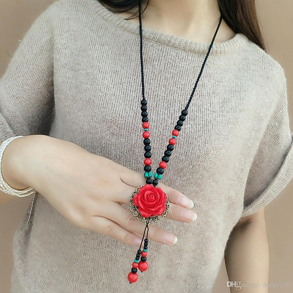 National wind flower sweater chain paint carved roses for Wind chain online