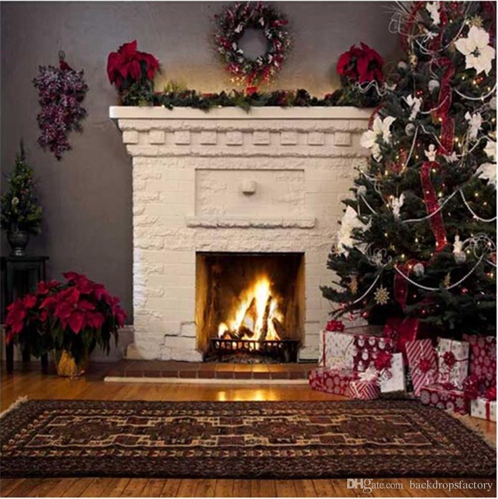 indoor white fireplace christmas backdrop decorated green pine
