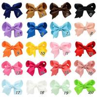100pcs 10 * 10cm 20 couleurs mixtes Archets Ruban avec clip solides arcs de couleurs arc de cheveux clip bébé pinces à cheveux accessoires boutique filles de cheveux 563
