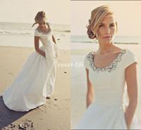 2015 Современные свадебные платья с карманами и короткими рукавами Scoop Бисероплетение тафта Белый Дешевые Весна пляж свадьбы Свадебные платья на заказ Made