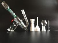 2015 Le vendeur paie / Livraison gratuite Deux fonctions étonnantes de forme de pistolet Les pétrolières de verre bongs en verre avec les pipes d'eau de verre de perc de coupe découpées avec 14.5mm