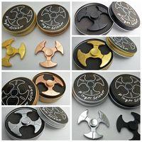 4 cores triângulo machado forma mão girador metal dedo brinquedo bom para autismo Fidget giradores brinca spinning top com caixa de varejo CCA5887 100pcs