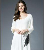 women modal long style printing t- shirts pure color asymmetr...