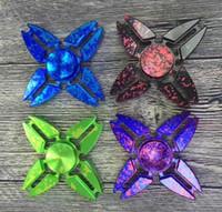 Starry Sky Spinner de mano Cuatro esquinas Cangrejos Dedo de los dedos Espiral Dedos Giro Torqbar Fidget Spinner 4 Colores OOA1542