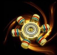 Mano luminosa Tri Fidget Spinner Torqbar EDC HandSpinner juguetes de la descompresión del juguete del foco divertidos con la caja OOA1310