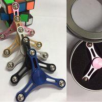 Slim cintura mano dedo Spinner Tri Fidget escritorio juguete EDC dedos Finger Gyro Fidget Spinner 5 colores con la caja al por menor 200pcs KKA1559