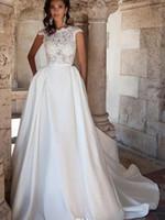 2016 Скромная новые кружева Свадебные платья Линия Sheer Jewel Шея Sexy Открыть Назад Свадебные платья рукава Cap Vestidos De Noiva