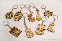 wood dragon - 2016 Mixed Styles Animal Wood Key Chains handbag charm Dragon Cat Crane y