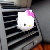 Precio de Car air freshener-últimos suministros ambientador de aire del coche 2pcs incienso HelloKitty perfume del enchufe del asiento del perfume del coche para el kit de coche auto del coche del accesorio auto del envío libre