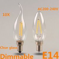 Wholesale 10pcs NEW E14 W W AC220V V Dimmable candle light Warm White CRI Degree Clear glass LED Filament Lamps Chandelier Bulbs E14 lamp