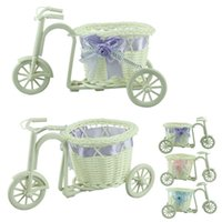 Wholesale Stylish big wheel round basket rattan floats flower vase flowerpots containers small flower bike flower pot