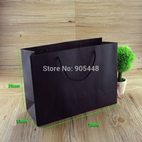Cheap 20pcs lot NEW Black kraft paper bag with handle shopping clothes bag Upscale Fashionable gift cookie packaging bags 35*26*13cm