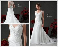 accent style - Custom Made Chiffon V neck with lace accenting the bodice and a buttons covered zipper illusion back Style Wedding Dresses