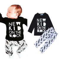 baby letter blocks - Retail INS Boy Clothing Set Cartoon Baby Girl Clothes New Kid On The Block Letter Long T shirt Feather Pattern Pants Kids Sets