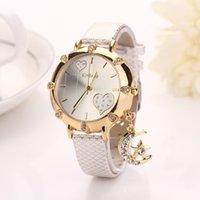 Precio de Cuero reloj pulsera corazón-Moda Nuevo Llegar Moda Ocasional Pulsera De Cuero Pulsera Reloj Mujeres Relojes De Pulsera Estrella De Luna Colgante Corazón Reloj