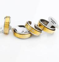 al por mayor espín corazón-36pcs / lot mezcló la venta caliente del diseño de la mariposa del corazón de los anillos de la vuelta del acero inoxidable del anillo del transporte de la plata del oro de la joyería de los hombres