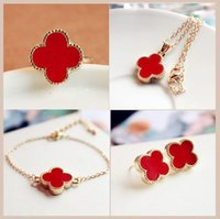 Wholesale Red black white leopard four kinds of color classic jewelry Korean cute Clover Necklace Bracelet Earrings Set