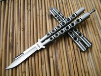 features - THE ONE Slot Blade Balisong Butterfly knife with Rivet Feature Steel Integrated handle C Irregular edge Tactical knives