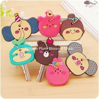 Wholesale Korea cute cartoon keychain can hang silicone key sets key protective cover creative keychain pendant factory
