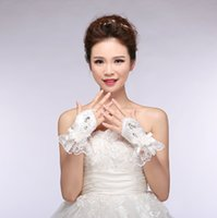 cotton gloves white - Elegant Wedding Gloves Beaded Shinning Bowknot Wrist Length Ring Finger With Lace Applique And Ruffles Gloves For Brides