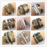 best pearl bracelets - Best Selling Designs Leather Bracelet Antique Cross Anchor Love Peach Heart Owl Bird Believe Pearl Knitting Bronze Charm Bracelets