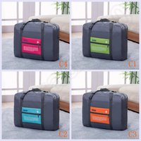 Wholesale 100PCS HAPPY TRAEVL Casual Nylon Foldable Luggage Bag Travel Bags Big Size Clothes Storage Carry On Duffle Bag Waterproof designs LJJJ33
