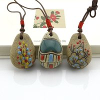 Wholesale Special spike creative hand painted ceramic Christmas ornaments decorated car door bell ornaments hanging jewelry bag
