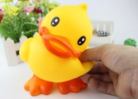 toy duck calls - Children take bath toy Stand up little yellow duck Speak yellow duck Paddle baby ducks Call voice is swimming beach toys