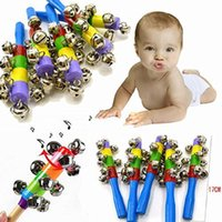 Wholesale Hot Colorful Rainbow Wooden Jingle Hand Metal Bells Cradle Music Shake Toys Hand Bell Inspiring For Baby And Kids
