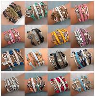 achat en gros de bracelet d'arbre à l'infini-Bracelets de charme d'Infinity de bricolage Bracelets de croix d'antiquité Vente chaude 55 styles Bracelets en cuir de mode Multilayer Arbre de coeur de bijoux de la vie
