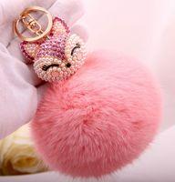 Wholesale Spot real rabbit pendant keychain car key chain full of diamond pearl stuffed raccoon dog Keychain