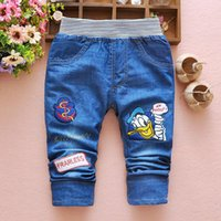 Wholesale fall new children s jeans fashion Europe cartoon boy pants