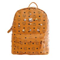 Wholesale HOT Women men s school bag backpack Special Offer PU Leather bags rivets backpack schoolbag