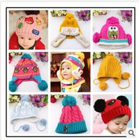 winter ear cap - 2015 New Arrival kids Children Knitted Hats Warm Hat Baby Winter Crochet Hat Baby Caps winter protect ear with Two Balls G232