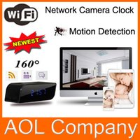 Wholesale Wide angle motion detection camera clock P palm size WIFI infrared night vision alarm clock camera moblie phone new partner IOS Android