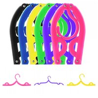 Wholesale Portable Colorful Travel Space Saving Clothing Hanger Foldable ABS Plastic Folding Drying Cloth Hangers Rack Clothes Peg