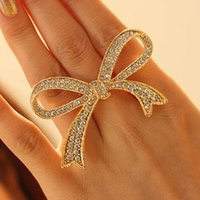 big bow rings - 2016 Korean fashion sweet and delicate gold plated white crystal rhinestone bow big rings for women Jewelry SR171