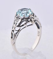 Wholesale Elegant sterling silver jewelry Austria aquamarine ring hollow out topaz stone ring fashion design decorative pattern