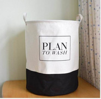 Wholesale white and black style canvas fabric laundry basket with cotton handle easy carrying and folded