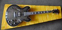 Wholesale G high quality transparent black electric guitar OEM