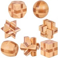 Wholesale 7pcs D Eco friendly bamboo wooden toys IQ brain teaser burr adults puzzle educational kids unlocking assembly games