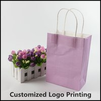 Cheap 21x15x8cm 30pcs lot New Style kraft paper bag with handle Party Gift Paper Bags Can customized Logo Printing