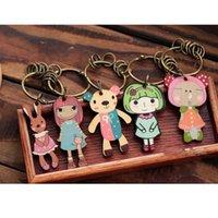 Wholesale animal key chains lovely girl key rings wood carve key rings doll keyrings